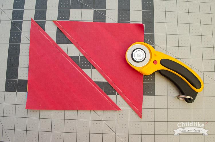 Sew two half square triangle pieces
