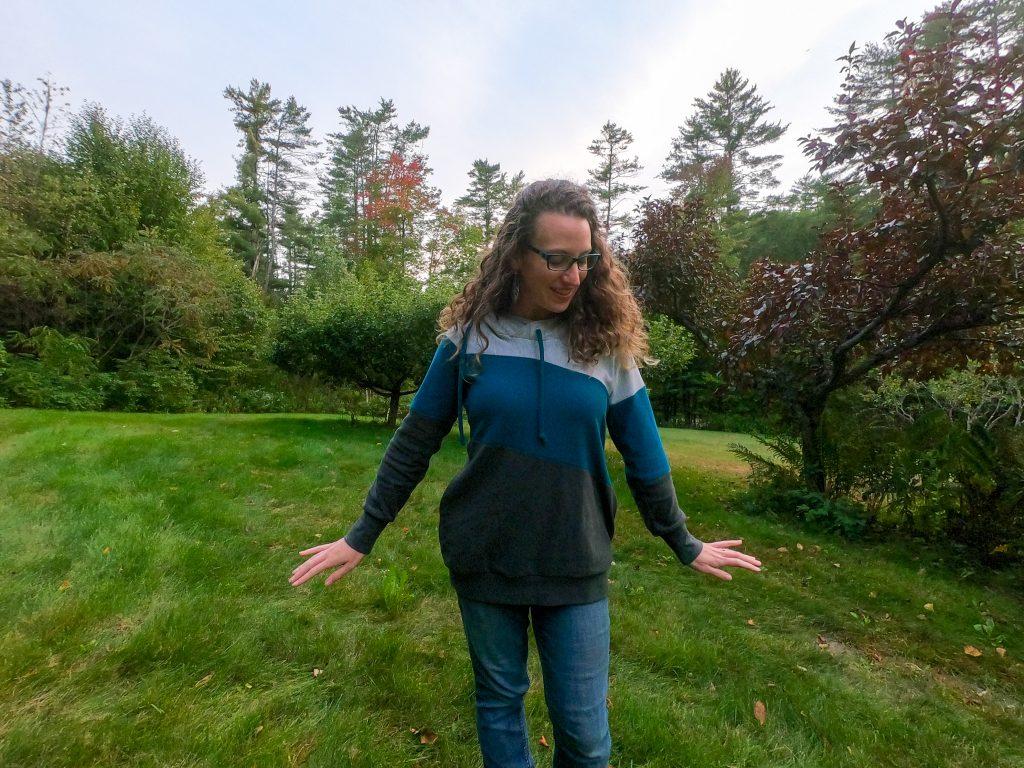 Picture of Terri in her yard wearing her homemade Around the Block hoodie
